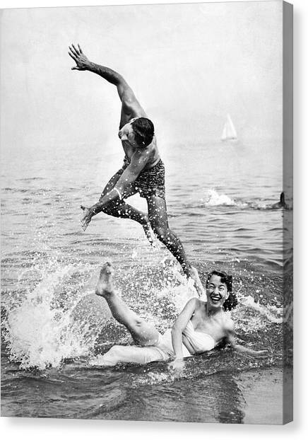 Boy And Girl Canvas Print - Couple Frolics In The Surf by Underwood Archives
