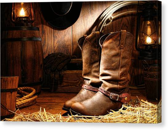 Cowboy Boots Canvas Print - Cowboy Boots In A Ranch Barn by Olivier Le Queinec
