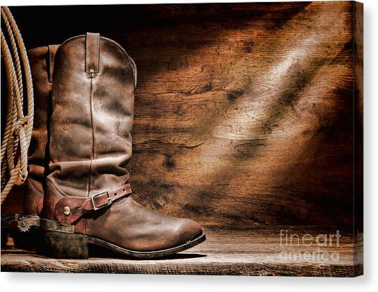 Spurs Canvas Print - Cowboy Boots On Wood Floor by Olivier Le Queinec