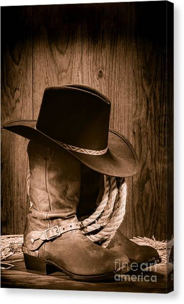 Lassos Canvas Print - Cowboy Hat And Boots by Olivier Le Queinec