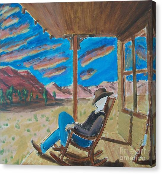 Cowboy Sitting In Chair At Sundown Canvas Print
