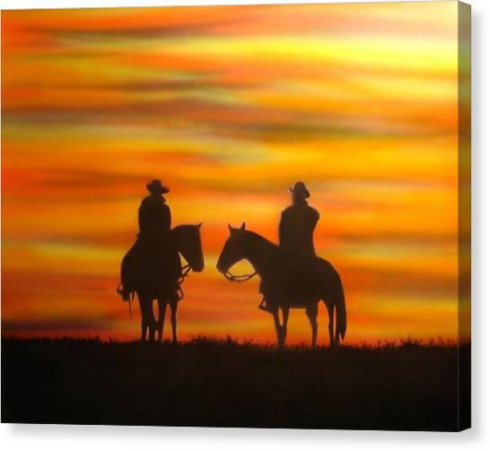 Cowboys At Sunset Canvas Print