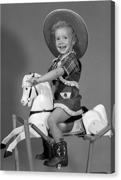 Funny Horses Canvas Print - Cowgirl On Rocking Horse, C.1950s by B. Taylor/ClassicStock