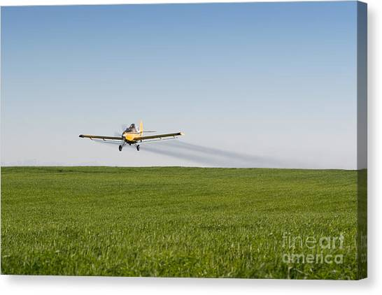 Crop Duster Airplane Flying Over Farmland Canvas Print
