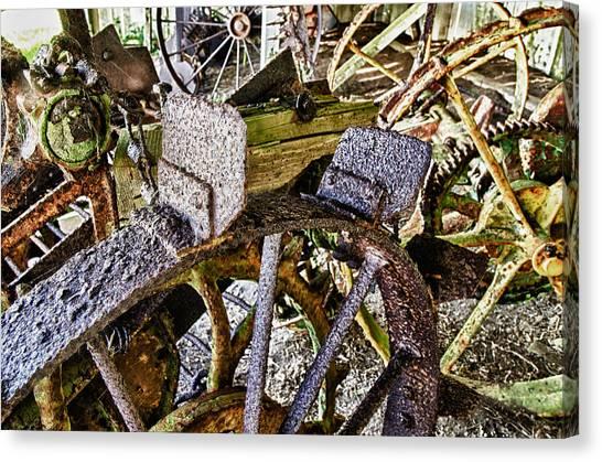 Crusty Rusty Tractor Wheels Canvas Print by Robert Rus