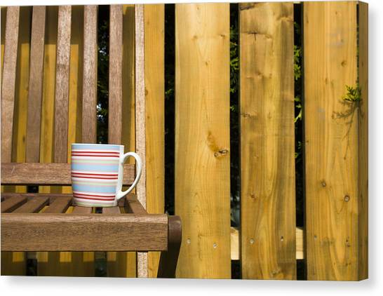 Cup On Garden Chair Canvas Print