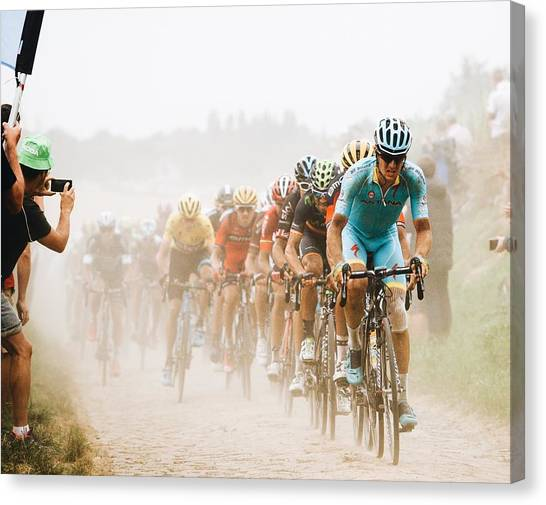 Cyclist Canvas Print - Cycling In The Dust by Carlo Beretta