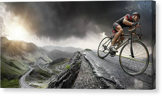 Cyclist Climbs To The Top Canvas Print by Peepo