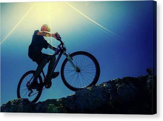 Cyclist On Bike Canvas Print by Wladimir Bulgar