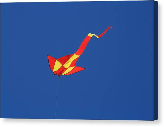 Deep Blue Sky And Kite Canvas Print by Phoenix De Vries