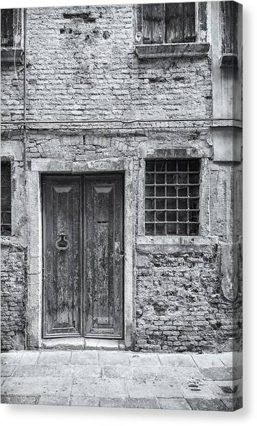 Detail Of Old Facade In Venice Canvas Print by Francesco Rizzato