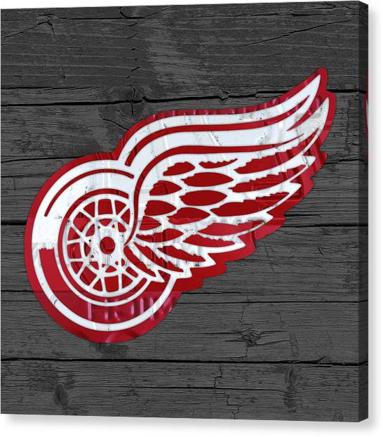 Detroit Red Wings Canvas Print - Detroit Red Wings Recycled Vintage Michigan License Plate Fan Art On Distressed Wood by Design Turnpike