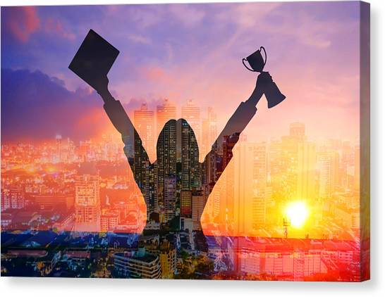 Digital Composite Image Of Woman Holding Award And Cityscape Against Sky During Sunset Canvas Print by Jirapatch Iamkate / EyeEm