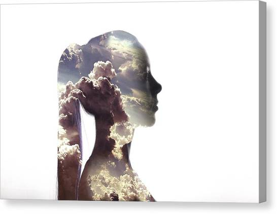 Digital Composite Of Woman And Cloudy Canvas Print by Roman Nasedkin / Eyeem