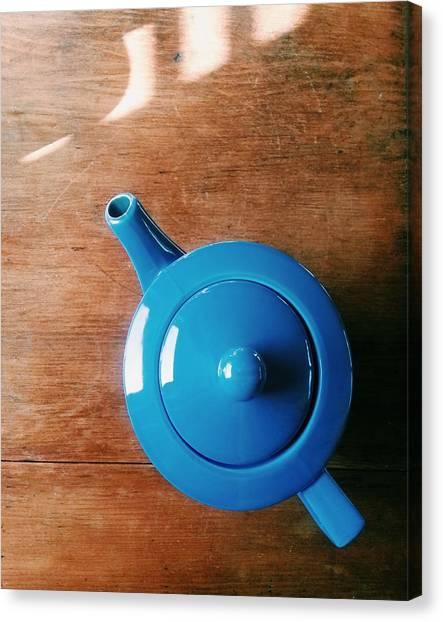 Directly Above Shot Of Teapot On Table Canvas Print by Timothy Kirman / Eyeem