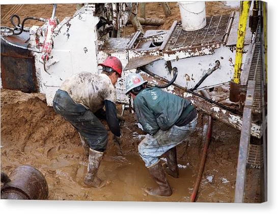 Hard Hat Canvas Print - Dismantling A Natural Gas Drilling Rig by Jim West
