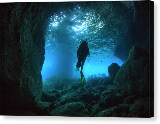Underwater Caves Canvas Print - Diver Swimming Through A Sea Cave by James White