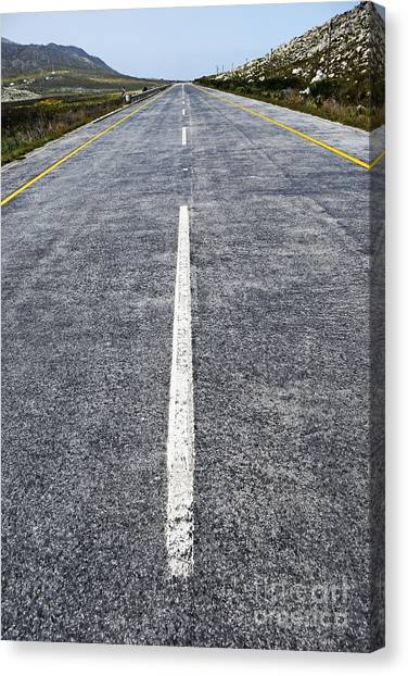 Dividing Line On A Highway Road Canvas Print by Sami Sarkis