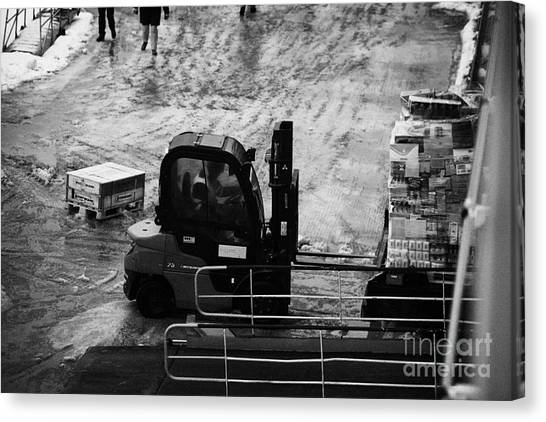 Forklifts Canvas Print - Dock Forklift Truck Unloading Deliveries From Hurtigruten Coastal Ferry Havoysund Finnmark Norway Eu by Joe Fox