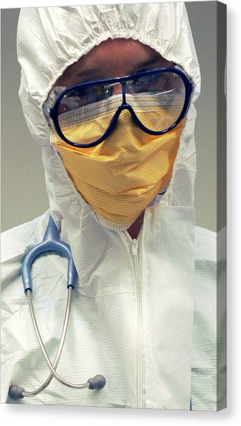 Biohazard Canvas Print - Doctor In Biohazard Suit by Public Health England