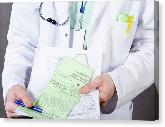 Health Insurance Canvas Print - Doctor With Health Insurance Form by Cedric Hatto/reporters/science Photo Library