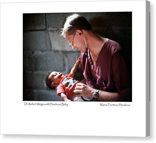 Doctor With Honduran Baby Canvas Print