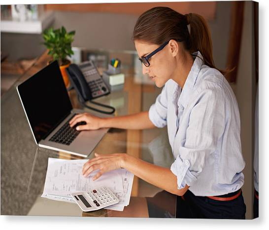 Doing Her Work At Home Canvas Print by PeopleImages