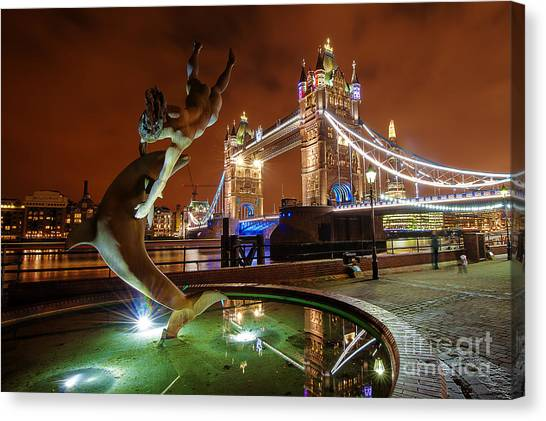 Dolphin Fountain Tower Bridge London Canvas Print by Donald Davis