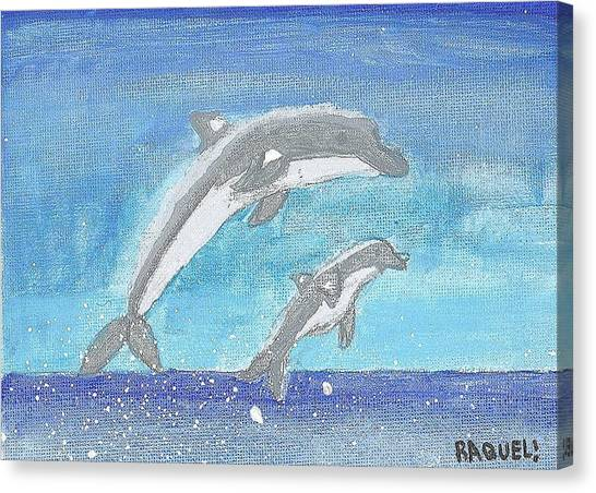 Dolphins Jumping Canvas Print by Fred Hanna