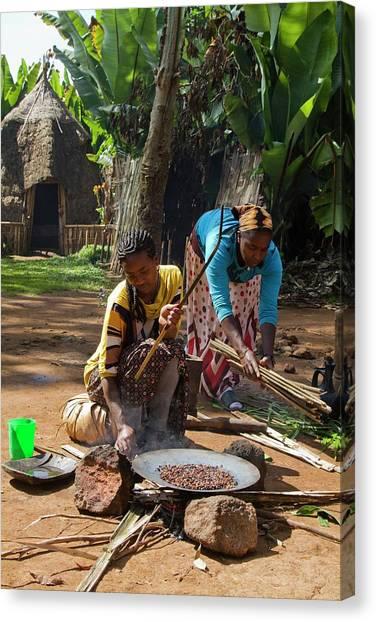 Ethiopian Woman Canvas Print - Dorse Woman Roasts Coffee Bean by Photostock-israel