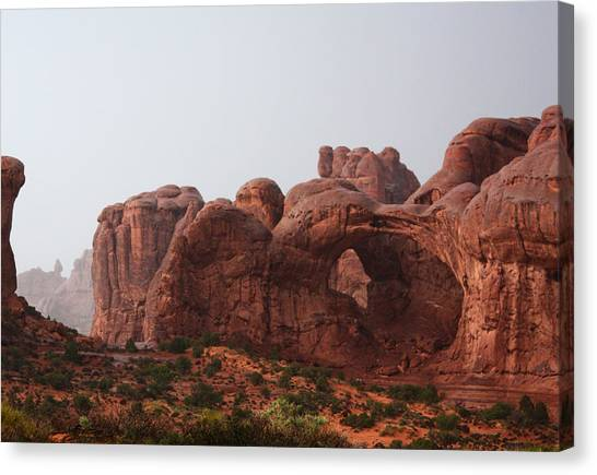 Double Arch In The Rain Canvas Print