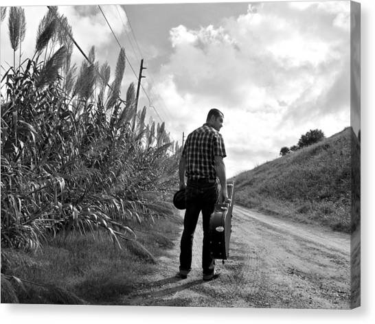 Down The Road Canvas Print by Thomas Leon