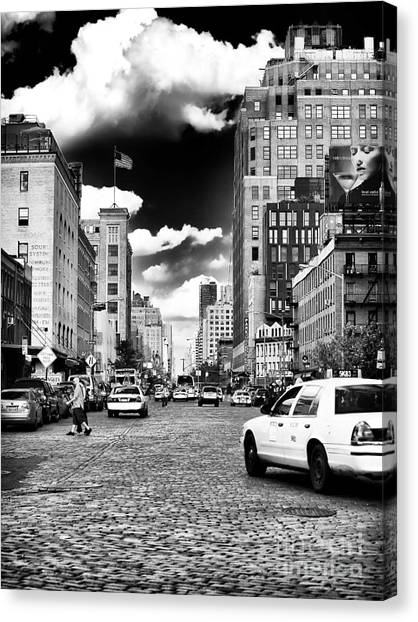 Downtown Cab Ride Canvas Print by John Rizzuto
