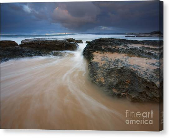 Beach Sunrises Canvas Print - Driven Between The Rocks by Mike Dawson