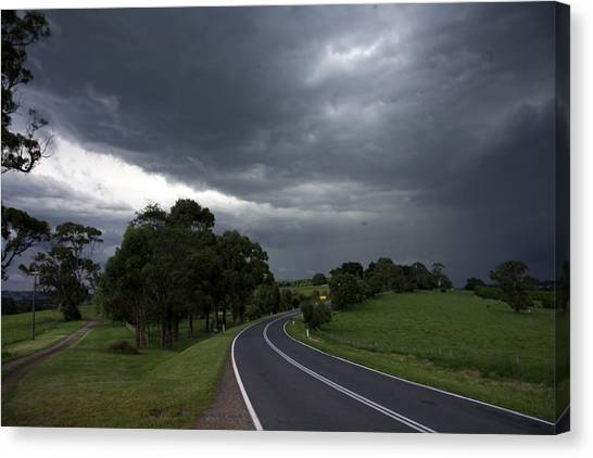 Driving Into A Storm Canvas Print by Lee Stickels