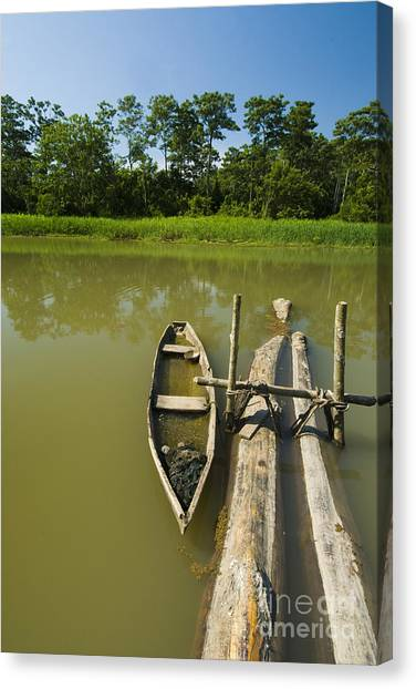 Amazon River Canvas Print - Dugout Canoe by William H. Mullins