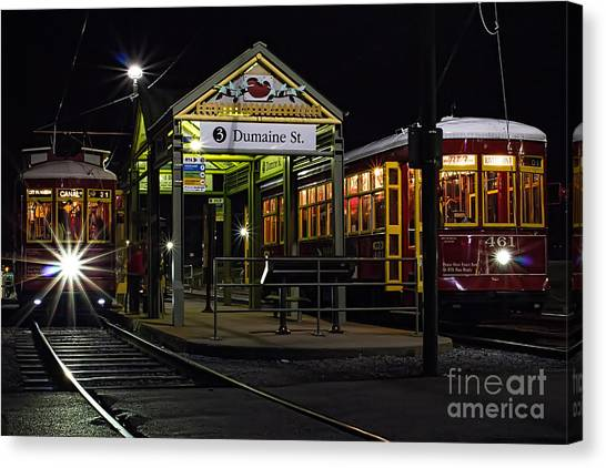Dumaine St. Trolly In New Orleans Canvas Print by Kent Taylor