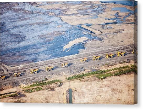 Dump Trucks Canvas Print - Dump Trucks At Tar Sand Mine by Ashley Cooper