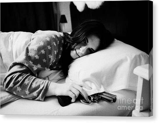 Early Twenties Woman Waking With Hand On Handgun Under Pillow At Night In Bed In A Bedroom Canvas Print by Joe Fox
