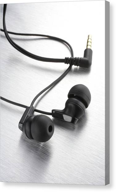 Earphones Using Neodymium Magnets Canvas Print by Science Photo Library