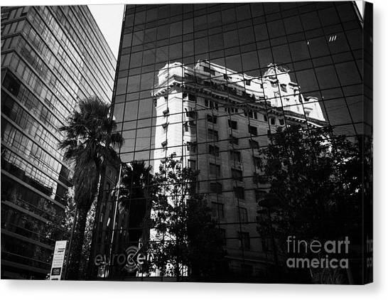 edificio ariztia building reflected in modern bank buildings in the financial district of Santiago Chile Canvas Print by Joe Fox