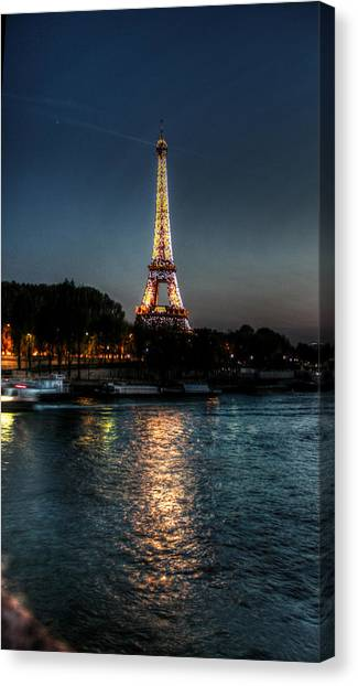 Eiffel Tower Night Time Canvas Print by Steve Ellenburg