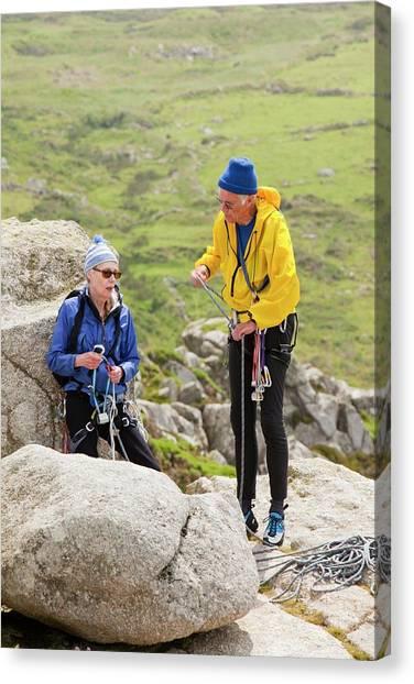 Ocean Cliffs Canvas Print - Elderly Rock Climbers by Ashley Cooper