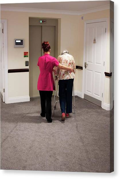 Elderly Woman With Carer Canvas Print by John Cole