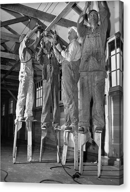 Balancing Canvas Print - Electricians On Stilts by Underwood Archives