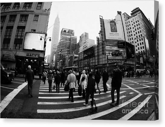 Manhatan Canvas Print - Empire State Building Shrouded In Mist As Pedestrians Crossing Crosswalk  New York City Usa by Joe Fox