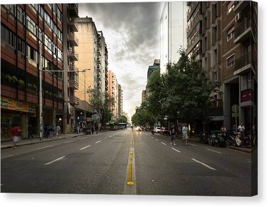 Empty Road Along Buildings Canvas Print by Andres Ruffo / EyeEm