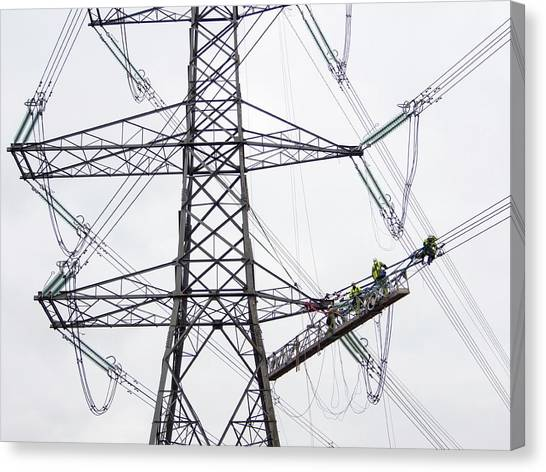 Vertigo Canvas Print - Engineers Working On Electricity Wires by Ashley Cooper