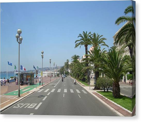 English Promenade At Nice Canvas Print by Tommy Budd