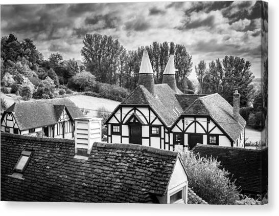 Canvas Print featuring the photograph English Rooftops. by Gary Gillette